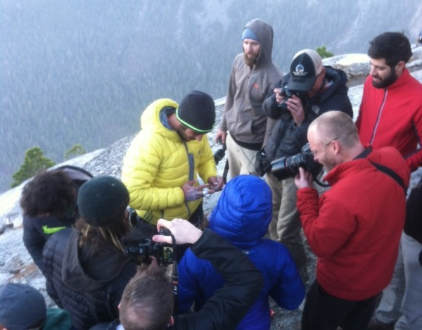 Reporters and photographers surround Kevin Jorgeson and Tommy Caldwell atop El Capitan. (Matt Brown/ The Press Democrat