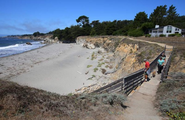 Tom Aswad, left, followed by Cindy Rubin, Donna Aswad and Jeff Rubin, walk along the newly re-opened trail with access to Walk-On Beach in the Sea Ranch on Friday, August 22. 2014 (Christopher Chung/ The Press Democrat)