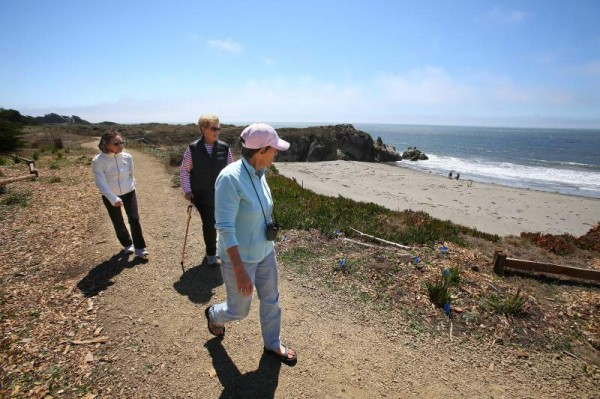Lauren Chaitkin, right Susan Levitt and Tanako Hagiwara walk along the newly reopened trail, at the site where erosion forced it's closure in 2004. In Sea Ranch on Friday August 22, 2014. The trail allows the public access to Walk-On Beach to the south. (Christopher Chung/ The Press Democrat)