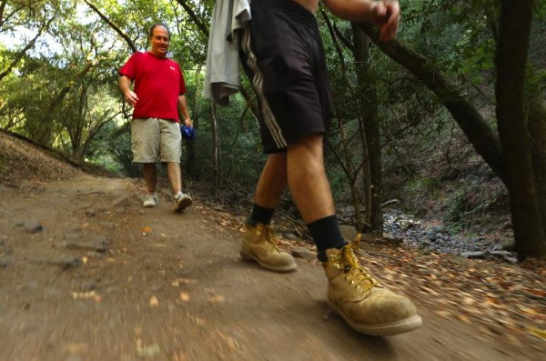 Rick Gittings of San Diego hikes behind his son Charlie from Lake Ilsanjo along the Spring Creek Trail in Annadel State Park. (John Burgess/ The Press Democrat)