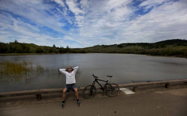 Jim McGary of Santa Rosa stretches in the sun on the Lake Ilsanjo dam, while on his lunch break. (Kent Porter/ The Press Democrat, 2011)